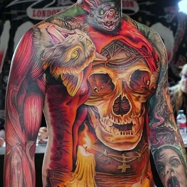 Glowing orange skull with candle mens stomach tattoo ideas