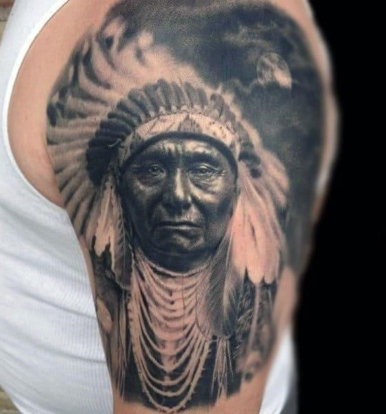 Grey shaded native american tattoo males arms