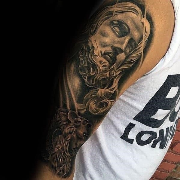 Guy with half sleeve shaded jesus tattoo design
