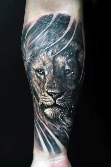 Guy with lion forearm tattoo design