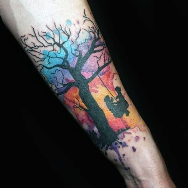 Guys forearms playing in swing watercolor tattoo