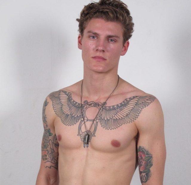 Hourglass angel winged chest tattoo