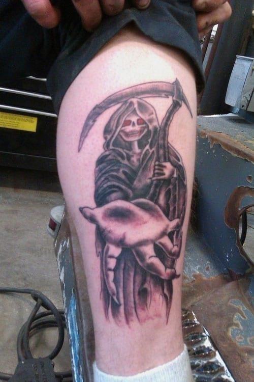 Inviting grim reaper tattoo for men