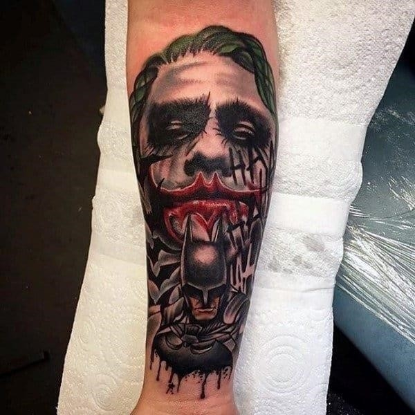Joker with batman mens inner forearm tattoo designs