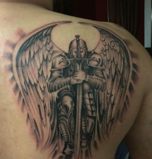 Knightly guardian angel tattoo for men