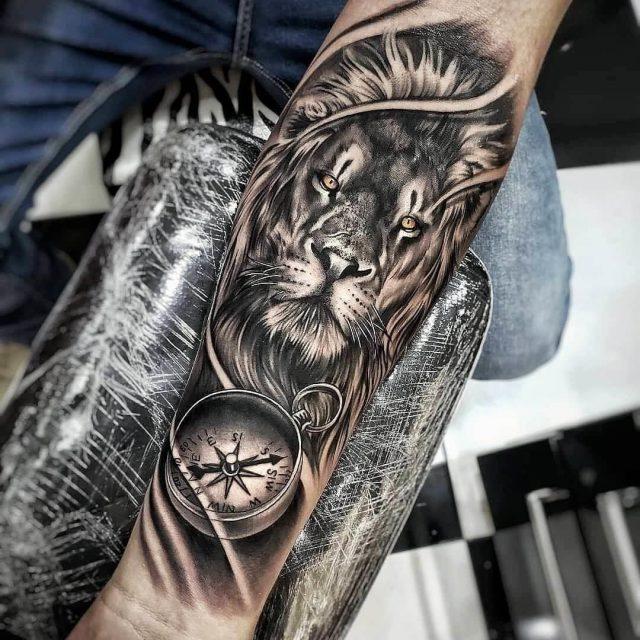 Lion compass tattoo art