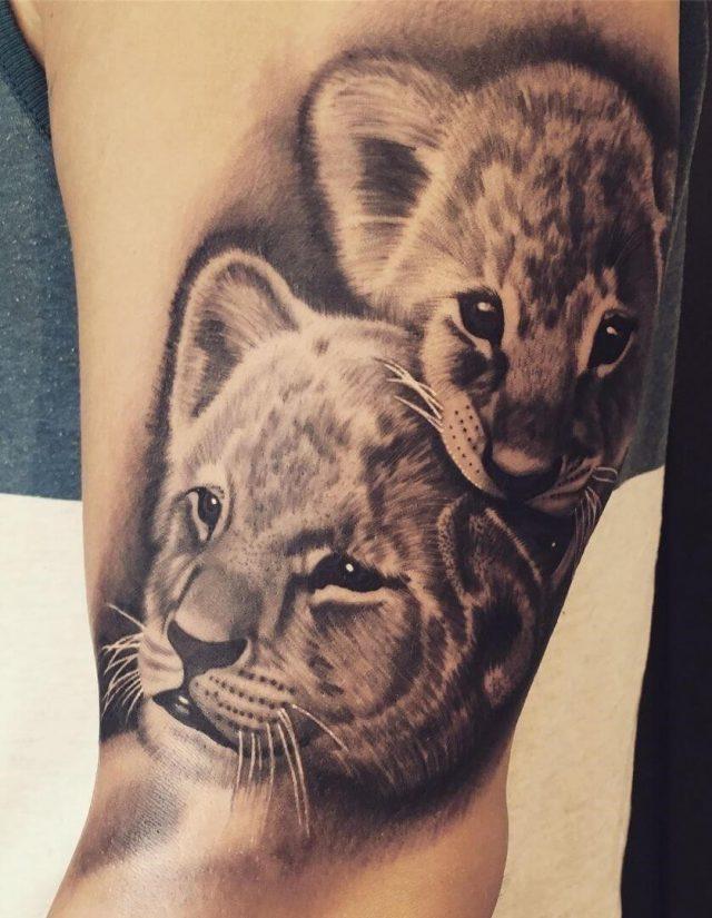 Lion cub tattoo arm