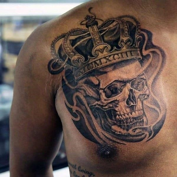 Male chest skull with imperial crown tattoo