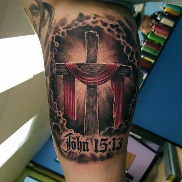 Male forearms great cross religious tattoo