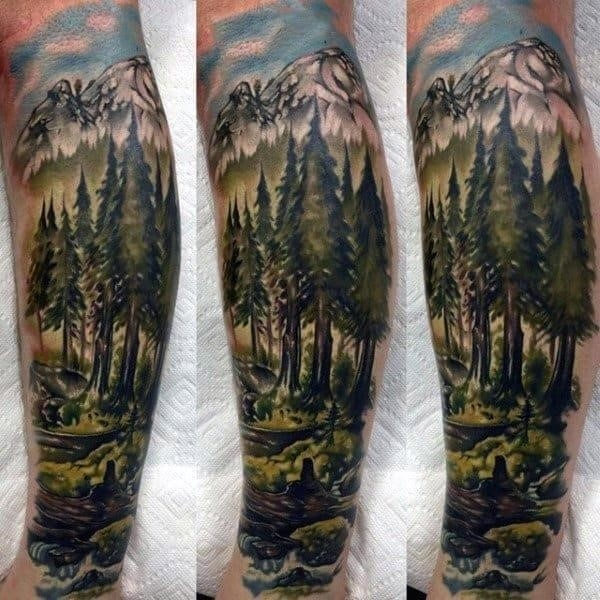Male forearms pretty watercolor trees forest hills tattoo