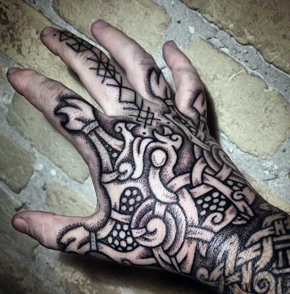 Male hands dark Norse tattoo