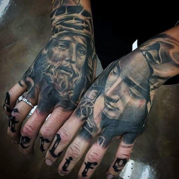 Male hands religious tattoo