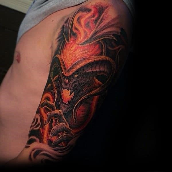 Male with tattoo of lord of the rings balrog sleeve design