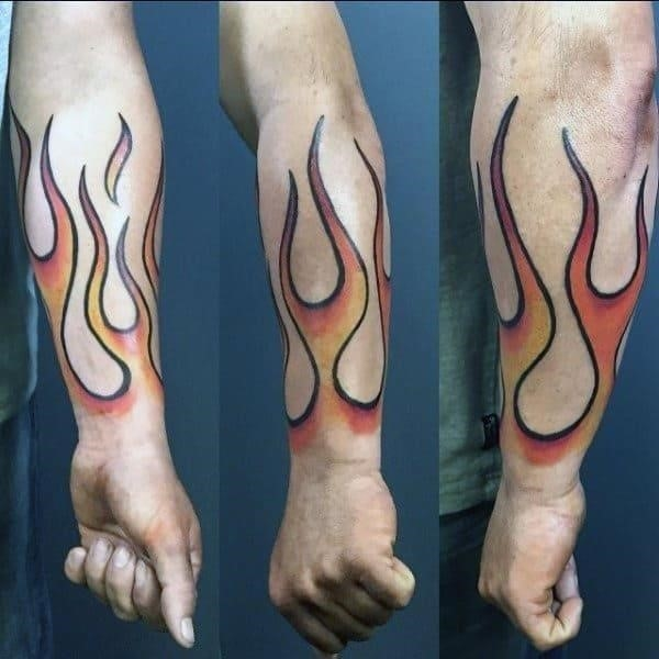 Man with fire forearm tattoo