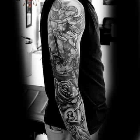 Man with religious tattoo on sleeves