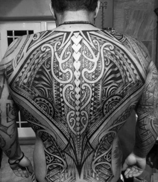 Man with tribal tattoos on the back
