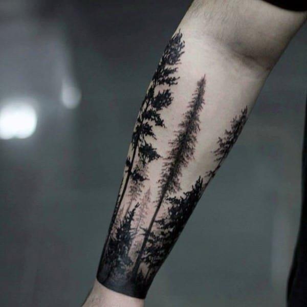 Masculine forest forearm tattoos for gentlemen