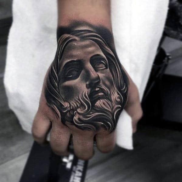 Masculine guys jesus hand tattoos