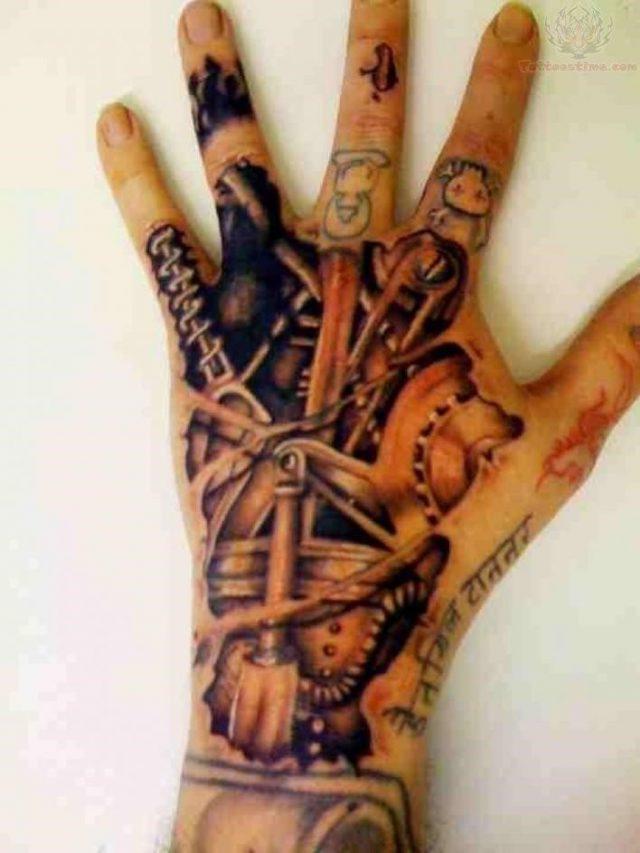 Mechanical back hand tattoo