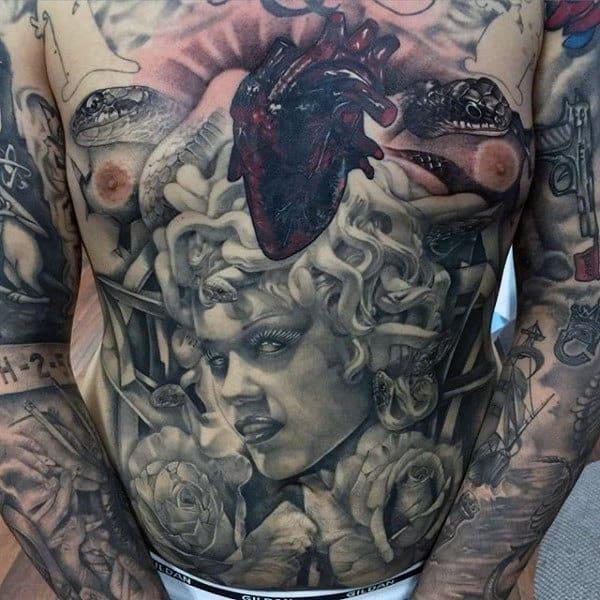 Medusa mens stomach piece tattoos