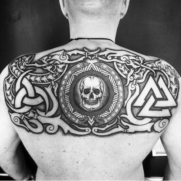 Mens black norse and skull tattoo on back