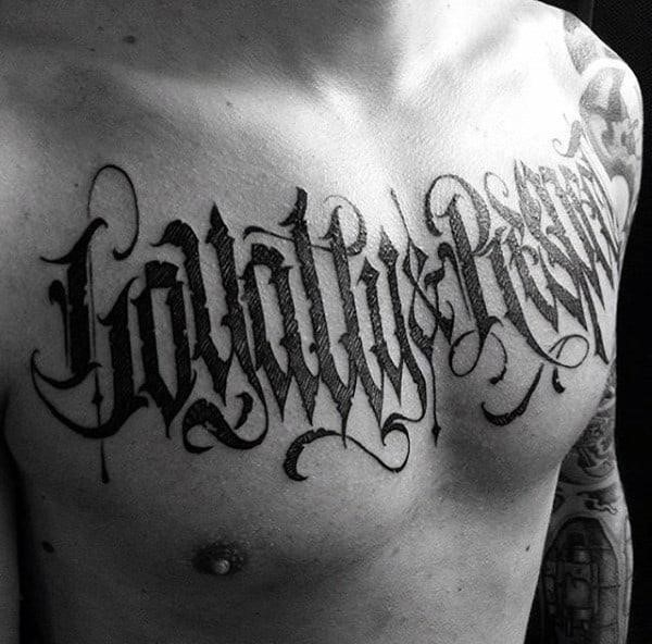 Mens chest horror lettering tattoo