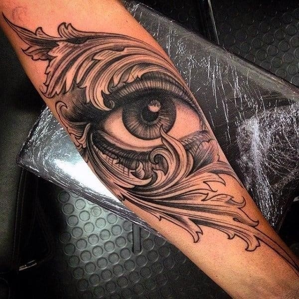 Mens forearms cool grey one eyed tattoo
