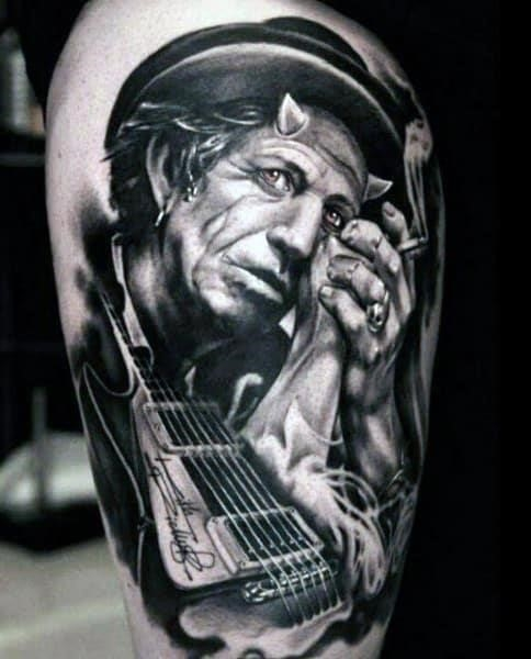 Mens guitar tattoo