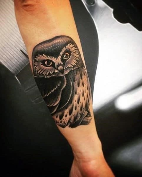 Mens owl chest tattoos on outer forearm