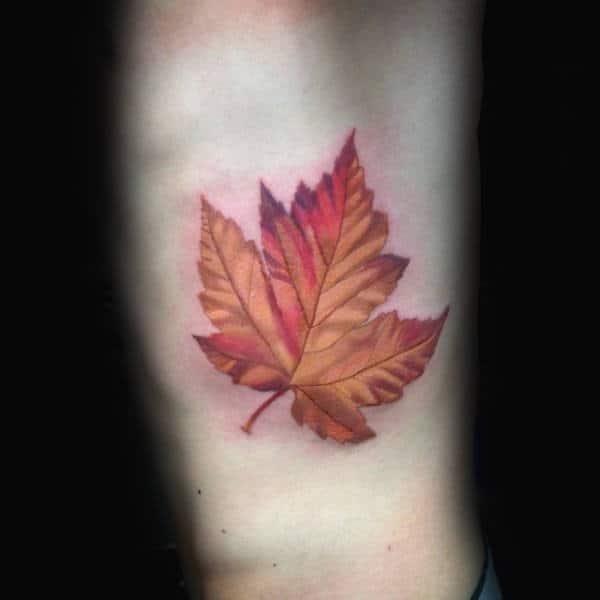 Mens rib cage side maple leaf tattoo idas