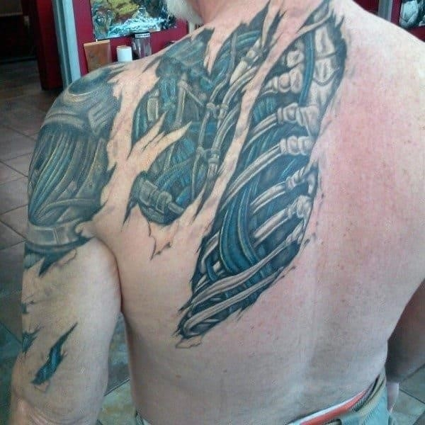 Mens ripped skin exposed spinal cord tattoo on back