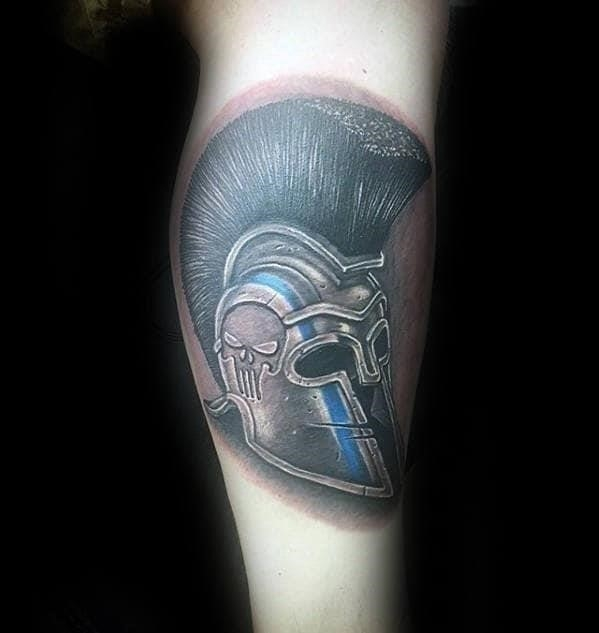 Mens spartan helmet with police thin blue line design tattoo on lower leg