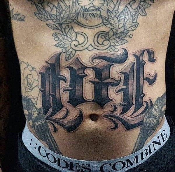 Mens torso black lettering tattoo