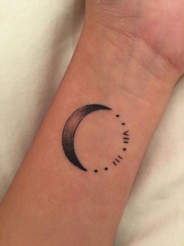 Moon roman numeral wrist tattoo white background