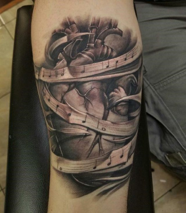 Music note tattoo3 650×744