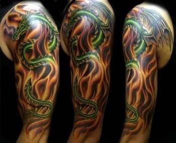 Nice fire n flame tattoo on left half sleeve