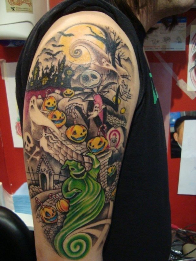 Nightmare halloween tattoo on man right half sleeve