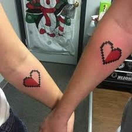 Opposite hearts matching couple tattoo