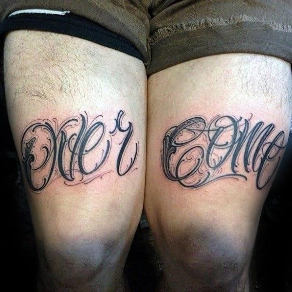 Over come mens lettering strength thigh tattoos