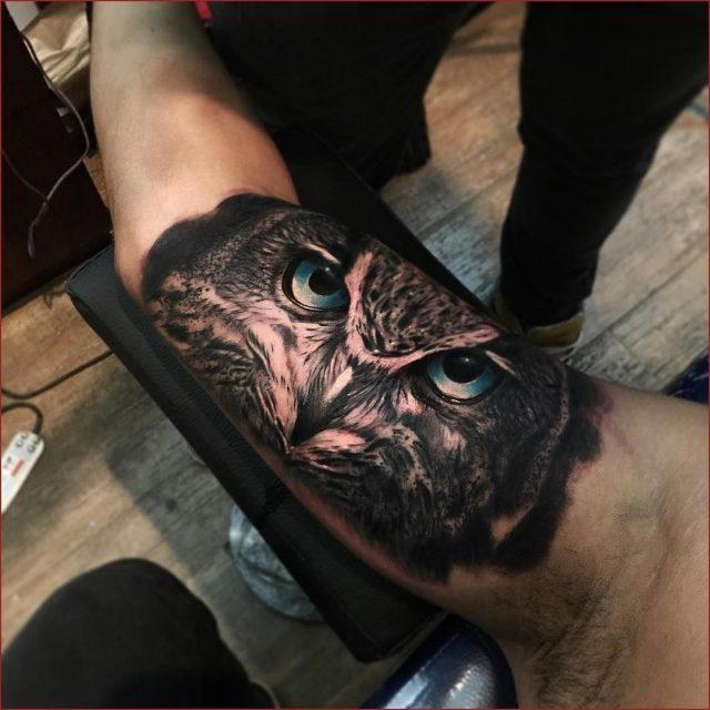 Owl face inner bicep tattoo for men