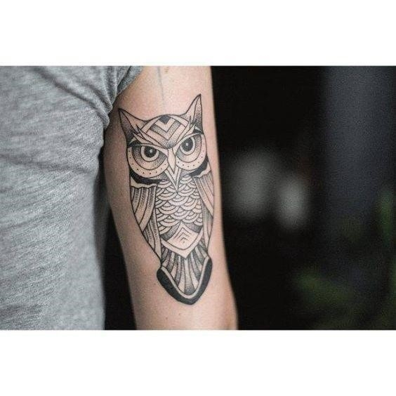 Owl triceps tattoo