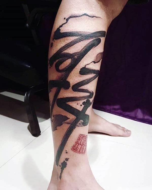 Paint brush stroke guys chinese lettering leg tattoos