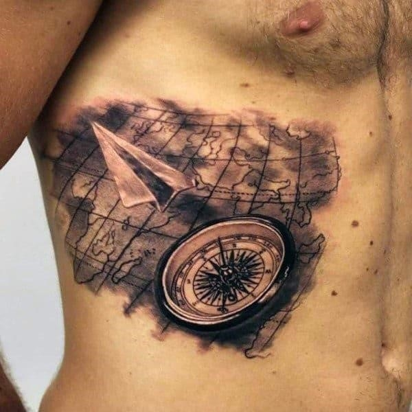 Paper airplane world map ribs tattoo for men