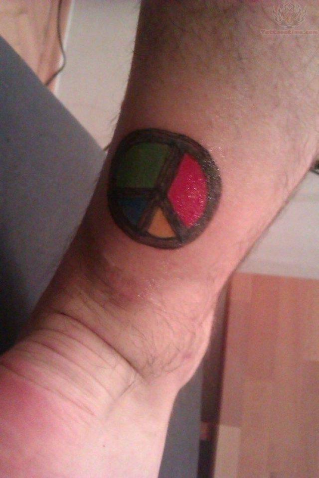 Peace and freedom tattoo on leg