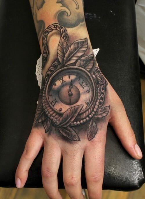 Pocket watch tattoo hand leaf