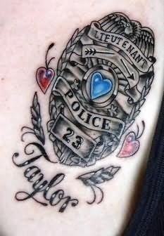 Police family crest tattoo on back