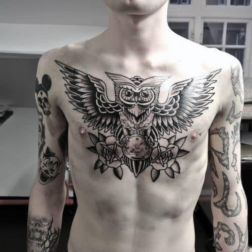 Retro traditional owl tattoo on mans chest