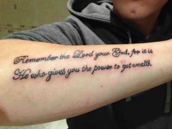 Right arm script tattoo