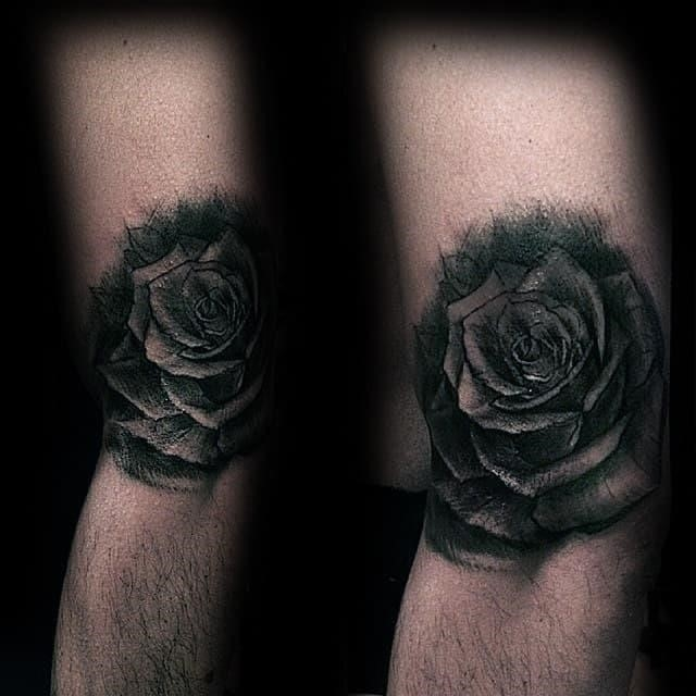 Shaded black rose arm tattoo on gentleman