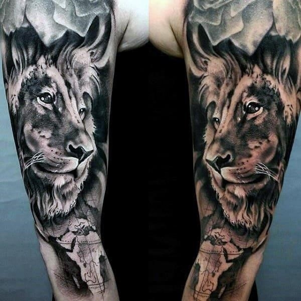 Shaded sleeve tattoo of lion on gentleman